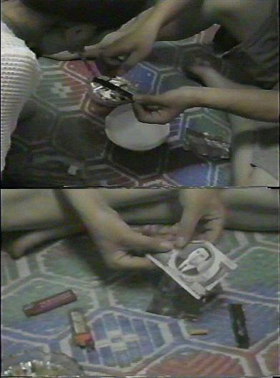 故金日成氏が描かれた紙幣でパイプをつくって覚せい剤を吸引する様子