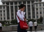 20150211北朝鮮携帯女性アイキャッチ
