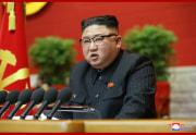 5日に開幕した朝鮮労働党第8回大会で事業報告を行う金正恩氏(2021年1月6日付朝鮮中央通信)